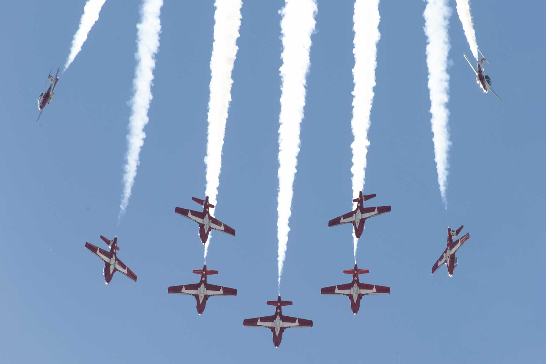 Canadian Forces Snowbirds aircraft diving straight down and trailing smoke