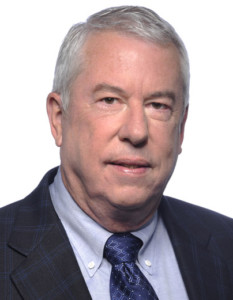 Head-shot portrait of man with gray hair, suit, and tie