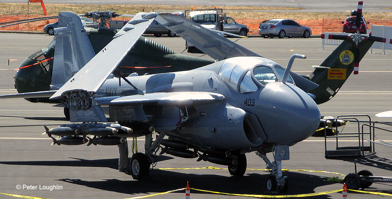 High-angle photo of an A-6E Intruder on the ground at an air show, wings folded.