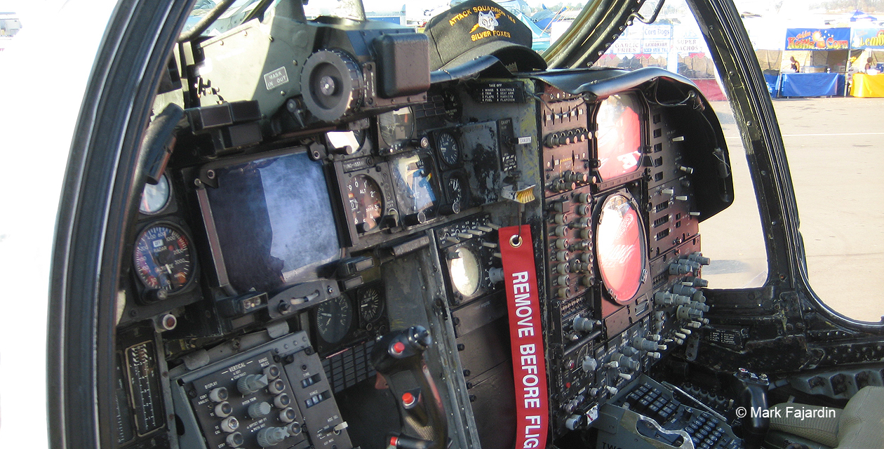 A-6E Intruder cockpit, showing side-by-side seating arrangement and many instruments, information screens, and controls.