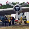 Emergency drill on the ramp at the Sonoma County Airport. This is a photo of an emergency response exercise, and shows firefighters and paramedics tending to fake