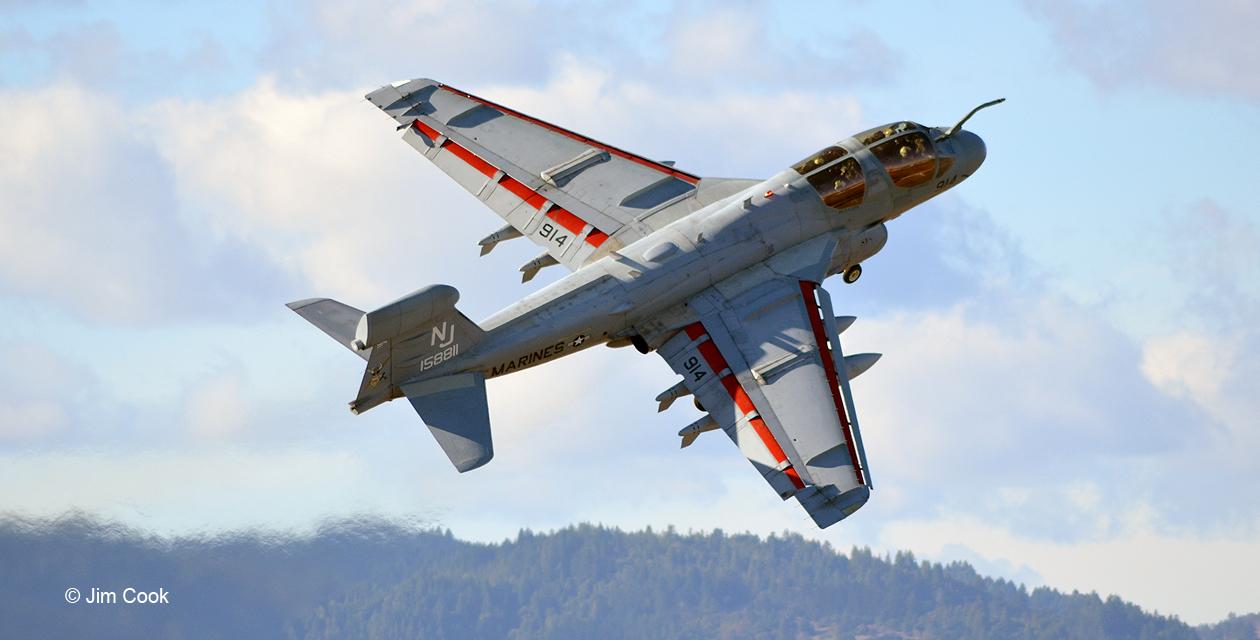 EA-6B Prowler electronic warfare jet aircraft making a steep climb and banking toward the camera, in flight.