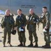 The four-man aircrew of EA-6B Prowler #158811 standing by the nose of the plane after its final flight.