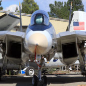 F-14 Tomcat on the ramp at the Pacific Coast Air Museum, viewed from directly ahead and slightly to the right.