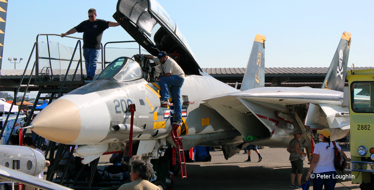 F-14A Tomcat at the 2014 Wings Over Wine Country Air Show, with canopy raised so visitors can look inside. Viewed from front left.