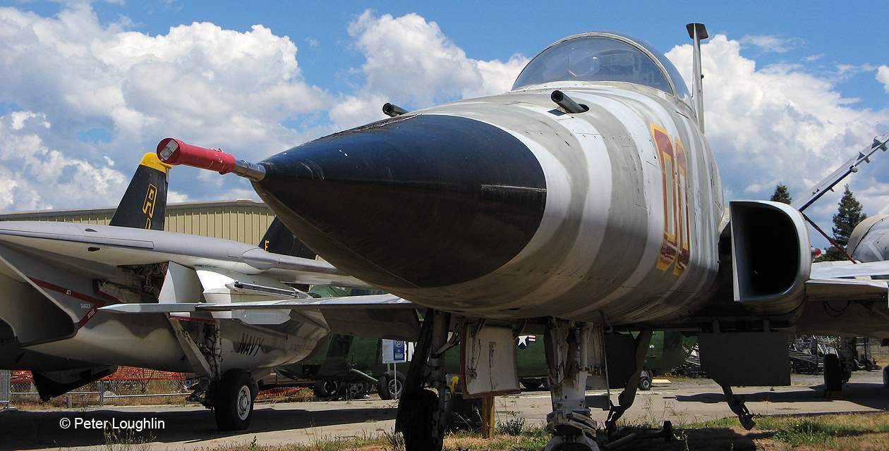 F-5E Tiger II jet fighter on the field at the Pacific Coast Air Museum. Close-up view of nose from front left.