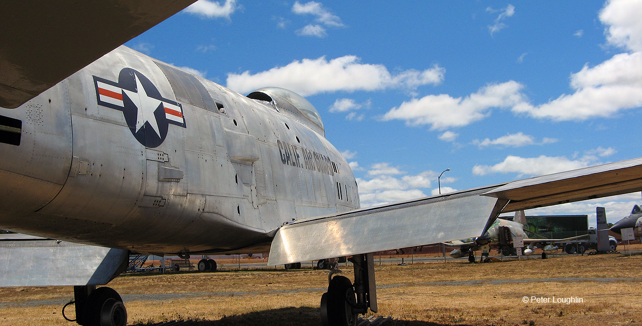 Close-up of the F-86H Sabre jet fighter, at the Pacific Coast Air Museum. View shows the side of the plane, looking at the landing flaps and wing root.