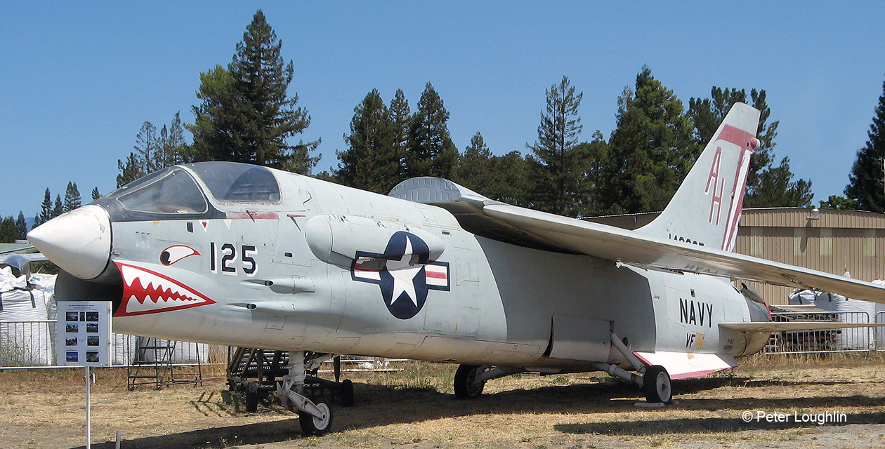 F-8U Crusader on the field at the Pacific Coast Air Museum, viewed from front left. The variable incidence wing is in the raised position.