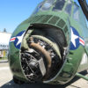 Close-up of the nose of the H-34 Choctaw helicopter. The engine compartment door is open, showing the nine-cylinder engine inside.