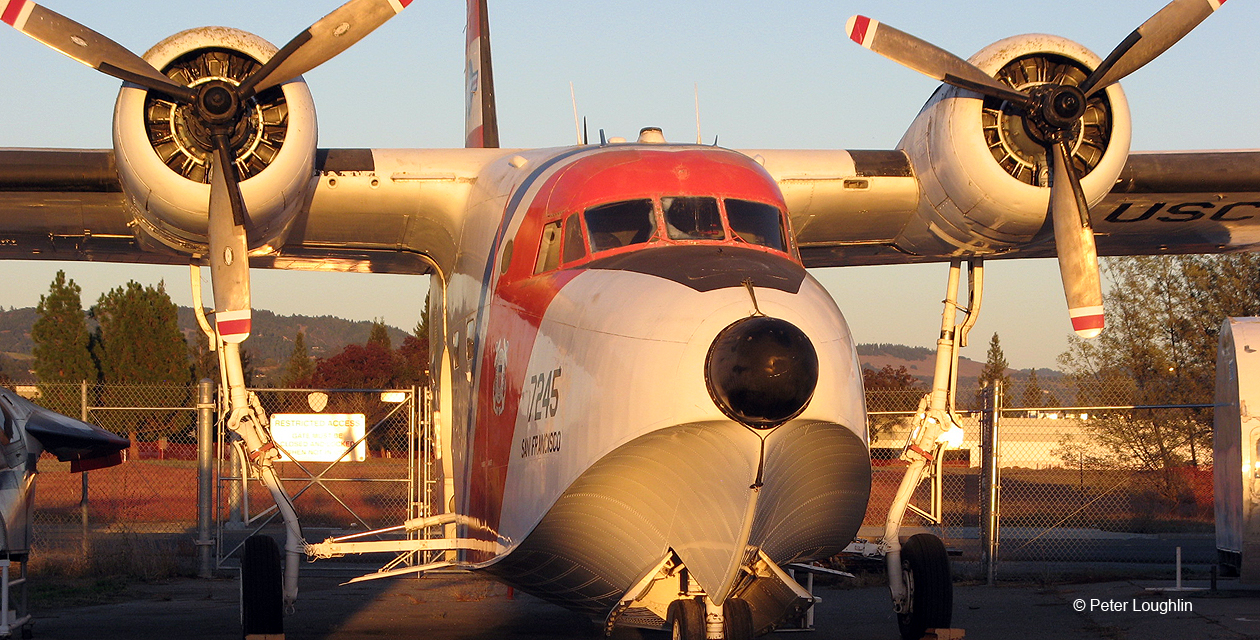 HU-16E Albatross amphibian seaplane at the Pacific Coast Air Museum, viewed from the front in golden sunset light
