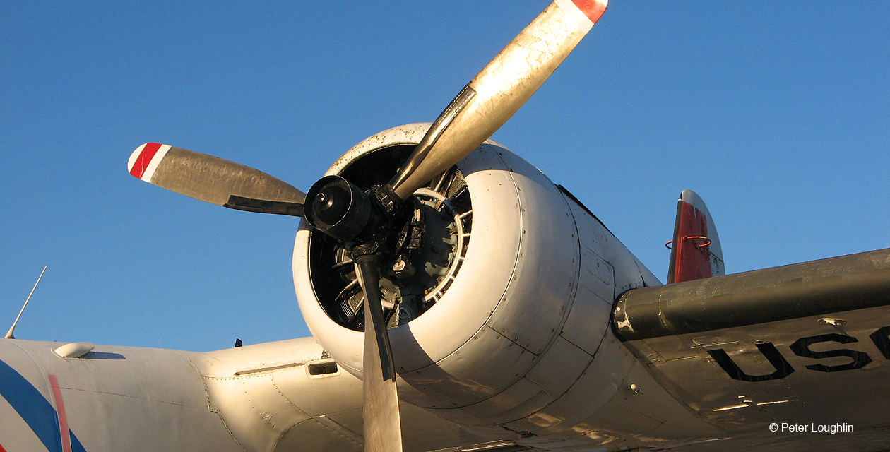 Close-up view of HU-16 Albatross left engine, looking upward at it.