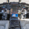 Pilot and copilot seats in the Lockheed Jetstar, shown from the rear and also showing the instrument panel, controls, and view out the windshield.