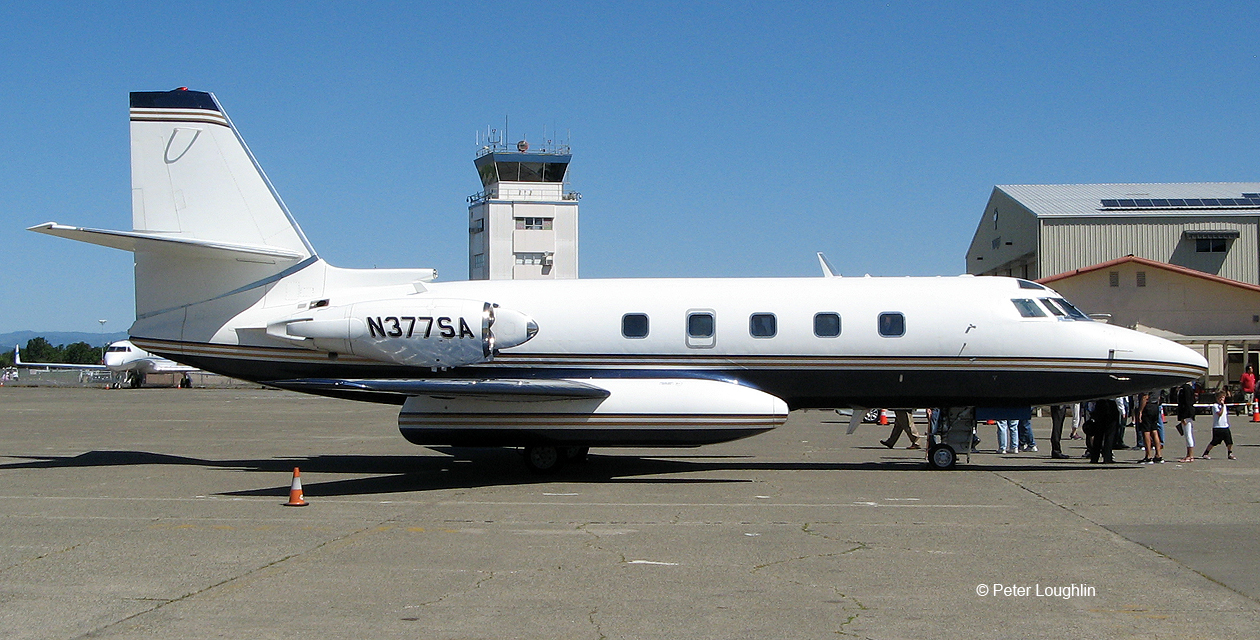 Lockheed Jetstar business jet, shown on the ground and directly from the side.