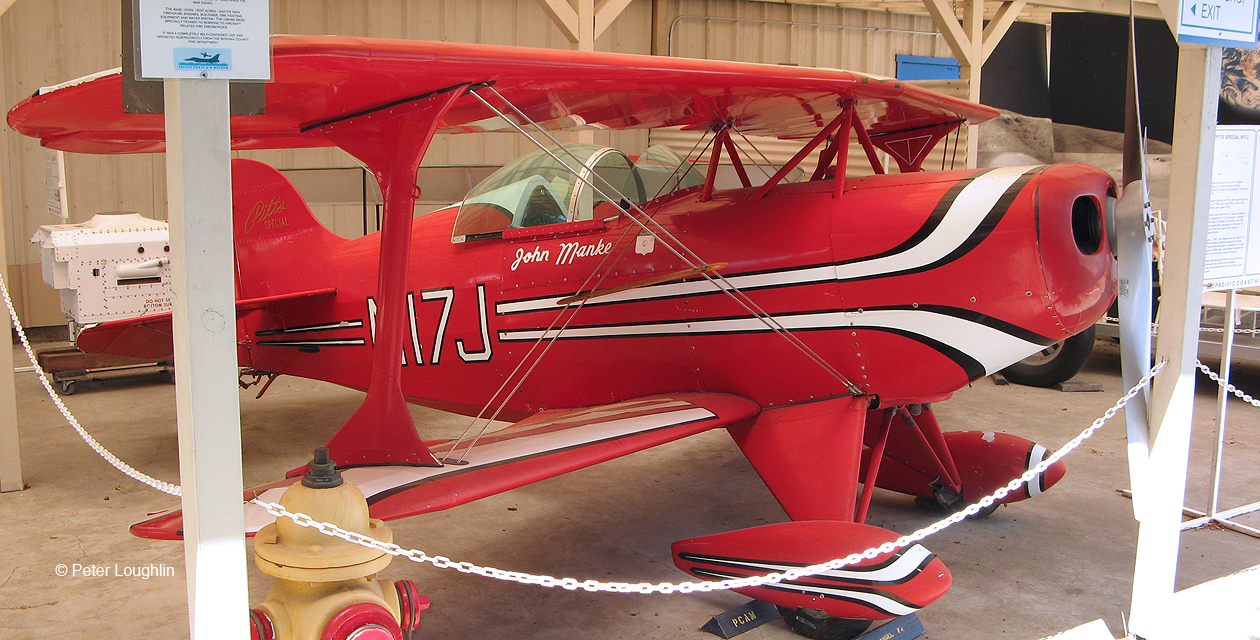 Pitts Special small red biplane on display at the Pacific Coast Air Museum