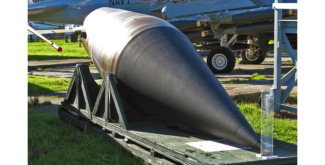 SR-71 spyplane engine intake spike. A large black cone-shaped object with a yellowish metallic base rests on a wooden palette.