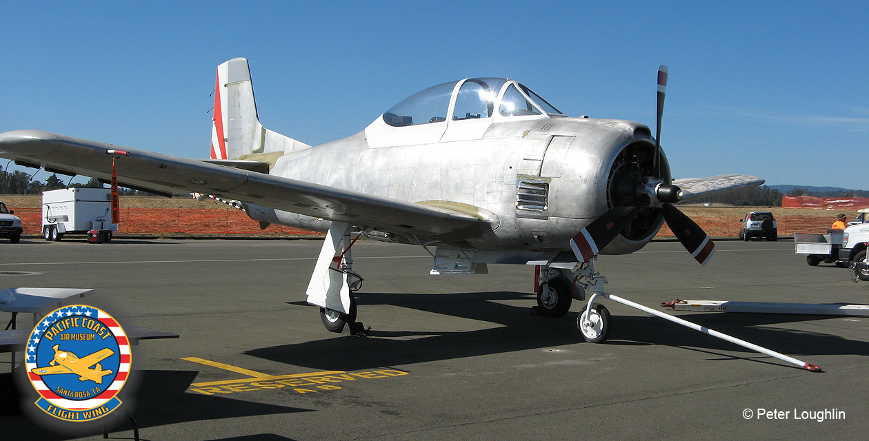 T-28 Trojan, stripped of most paint, on the ramp at the 2016 Wings Over Wine Country Air Show