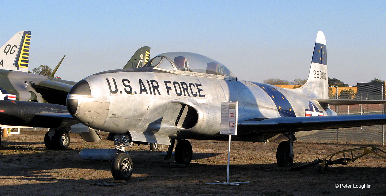 Photo of a T-33 Shooting Star jet trainer on the field at the Pacific Coast Air Museum, from the front left.
