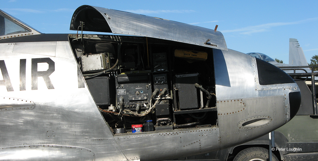 Close-up photo of T-33 Shooting Star nose compartment, showing equipment inside.
