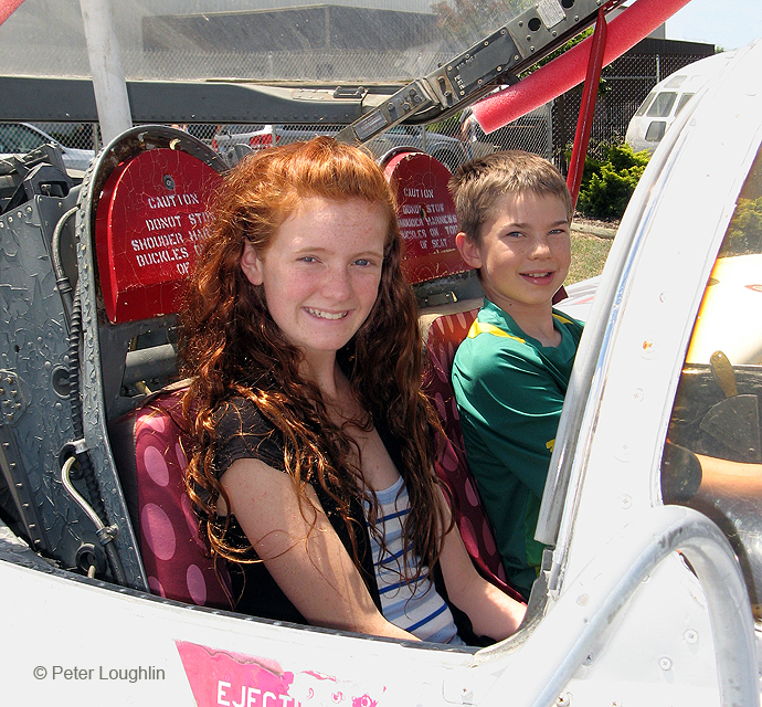 Open Cockpit Day. Closeup shot of two children sitting in the T-37 Tweet jet trainer.