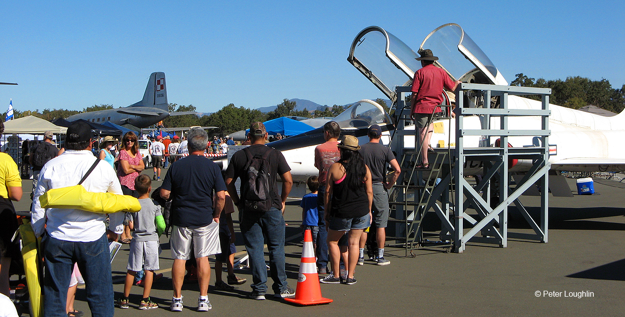 The T-38 Talon at the 2016 Wings Over Wine Country Air Show, with canopies open and a line of people waiting for their turn to climb aboard.