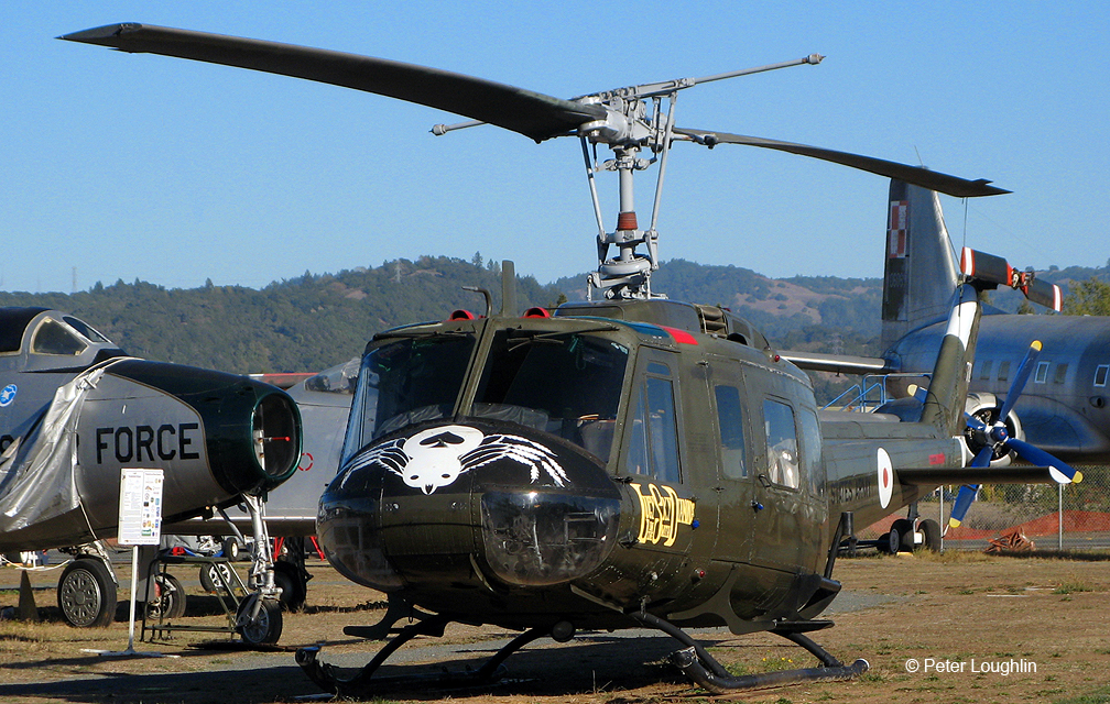 UH-1H Huey helicopter sitting on the field at the Pacific Coast Air Museum
