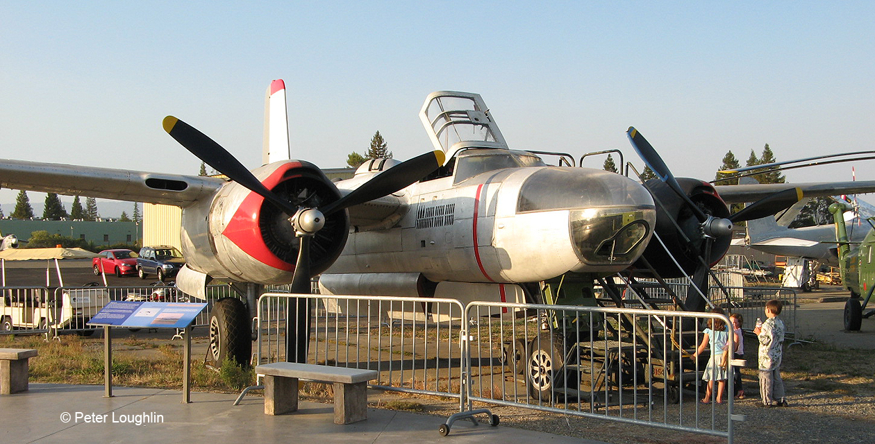 A-26 Invader twin propeller engine attack bomber on the field at the Pacific Coast Air Museum. Viewed from front right.
