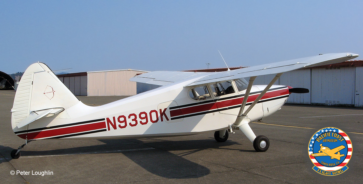 Stinson 108 Voyager, high-wing taildragger civil aircraft painted white with a red stripe. viewed from right side and slightly aft