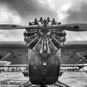 Antique Ford Tri-Motor aircraft on the ground viewed from the front, in black and white