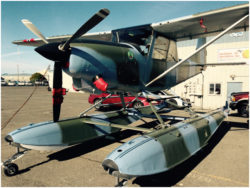 Float-equipped SIAI-Marchetti SM-1019 on the ramp at an airport