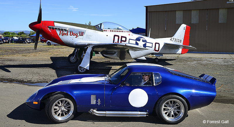 Shelby Cobra on display in front of P-51 Mustang Fighter plane