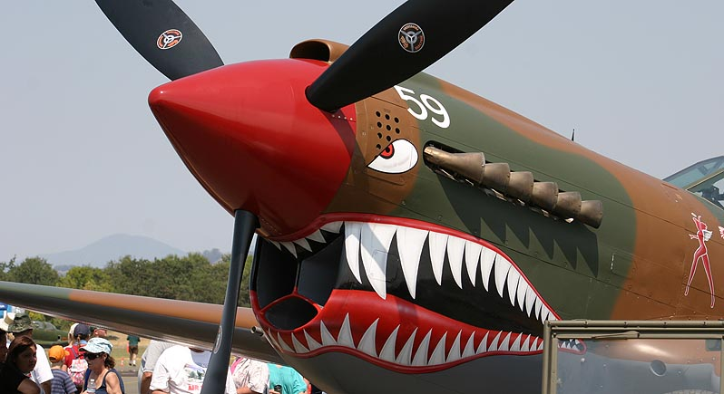 Close-up photo of nose of P-40 Warhawk painted with AVG shark mouth