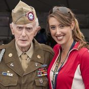 Elderly 101st Airborne Veteran and young woman