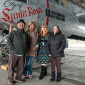 Family of Willis Tupper stands in front of PCAM A-26 Invader dubbed City of Santa Rosa