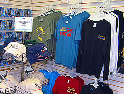 clothing on racks for sale in the gift shop