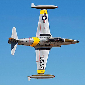 close-up photo of T-33 jet trainer doing a knife-edge flyby