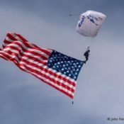 USAF Wings of Blue parachute jumper trailing the US Flag
