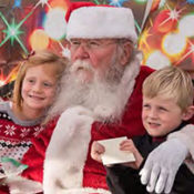 Santa Claus sitting with two young children