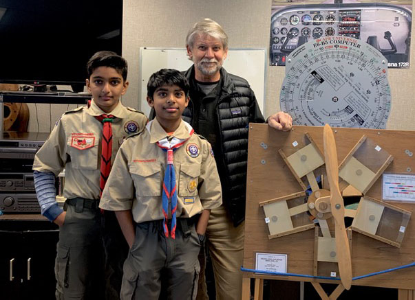 two scouts with instructor Art Hayssen at PCAM aviation merit badge class