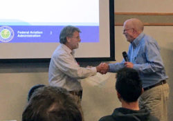 Art Hayssen receives his FAA award, shaking hands with the award presenter