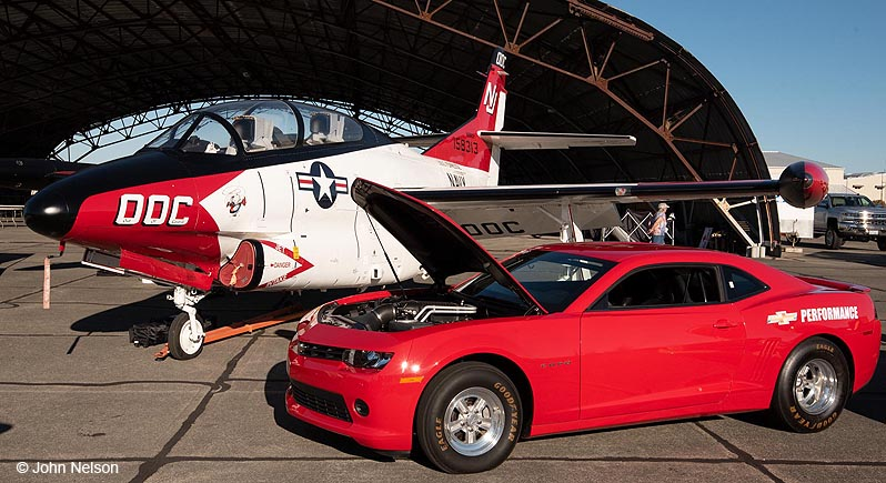 A jet trainer and lat model Ford Mustang at the Wheels & Wings Car Show at the Pacific Coast Air Museum