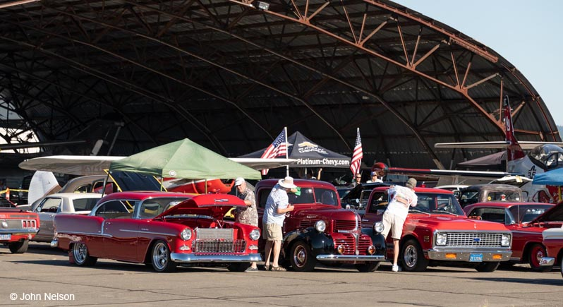 A lineup of classic cars at the Wheels & Wings Car Show at the Pacific Coast Air Museum