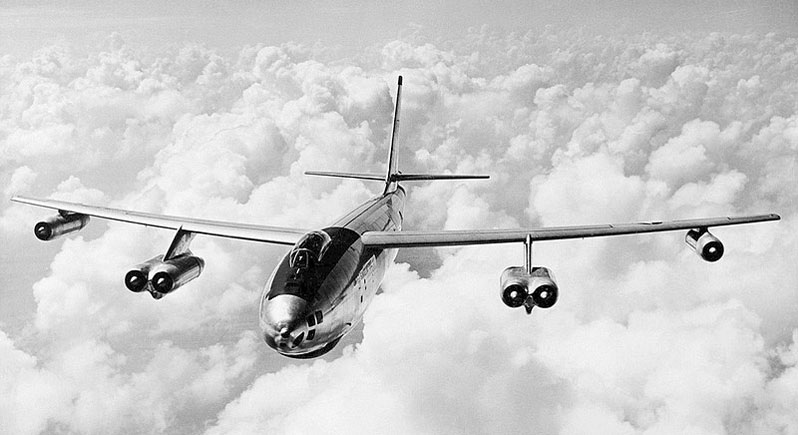 Black-and-white in-flight photo of Boeing B-47 Stratojet over clouds